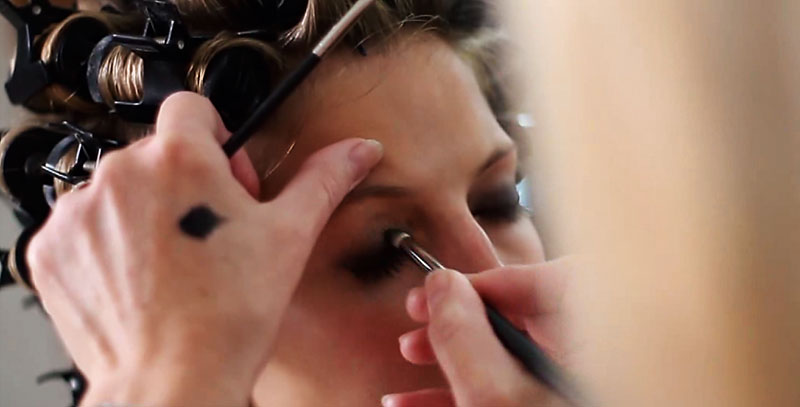 Applying makeup with hairdressing services