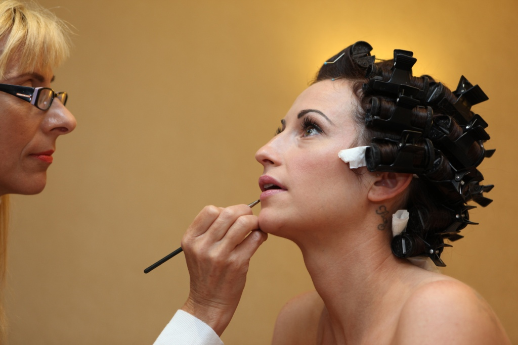 Claire Wallace applying makeup to a client