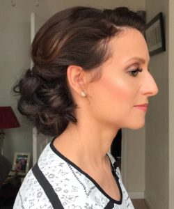 photo of client in profile, brown hair in up do