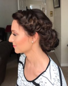 photo of client in profile, brown hair up in french plait