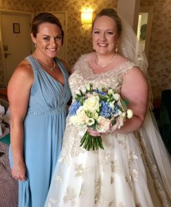 photo of bride in white dress and bridesmaid in blue
