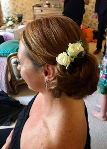 side shot of adult bridesmaid's hair with roses