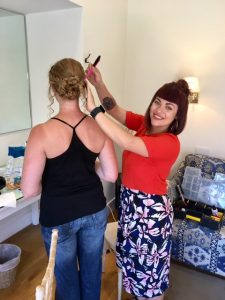 Photo of stylist Elloise at work on a clients hair