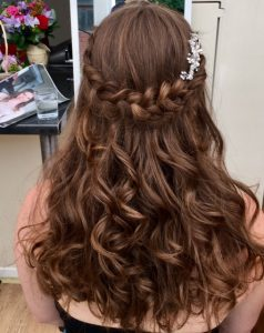 photo of back of head, long brown burls with palit detail and diamond hair clip