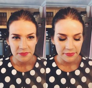 photo of brunette wearig blac and white polka dot deess, close up on her face, read lips and smoky eyes