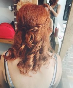 1 photo of red haired bridesmaid with curls and a plait