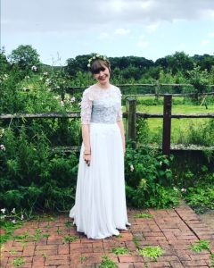 photo of bride on weddi g dress with countryside ion background