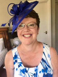 photo of smiling mother of bride wearing blue hat