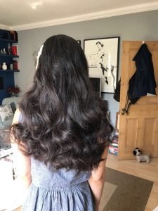 photo of long dark haired bride to be , taken from the back, she has curls