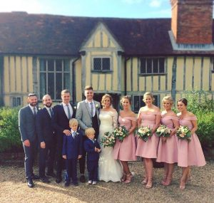 photo of weddi g party including best men, groom , bride bridesmaids and page boys