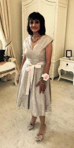 Photo of pertty mother of the bride in grey silk knee length dress