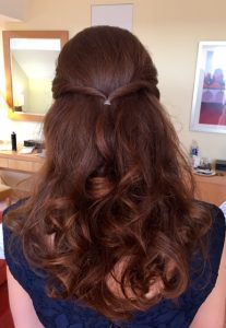photo of back of bridesmaids head, brunette curls