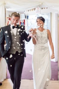 photo of bride and groom with confetti