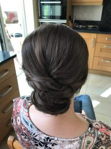 photo of back view of bride to be's hair. Brunette in chignon